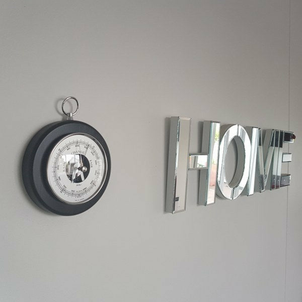wall hung black and chrome barometer