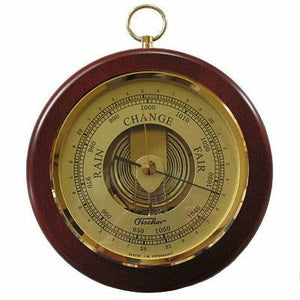 Fischer wall mounted round barometer with brass hoop