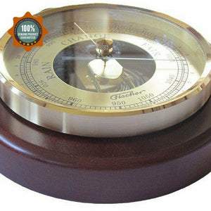 brass and wood barometer