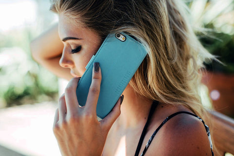 woman using safesleeve blue case