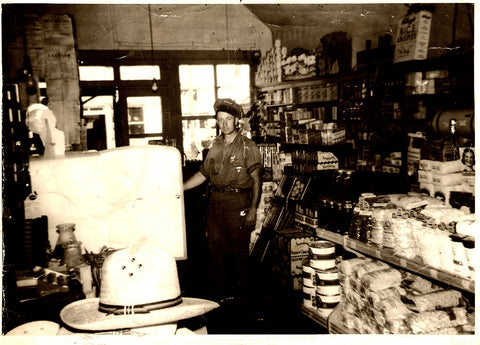 Great-Grandpa Shot in his store.