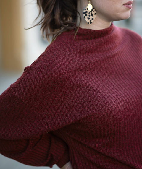 SELA top in Dark Wine + Cheetah Cora earrings
