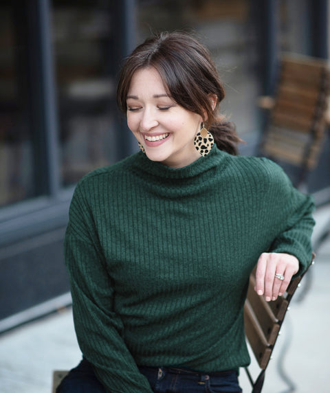 SELA top in Hunter Green + Cheetah Cora earrings