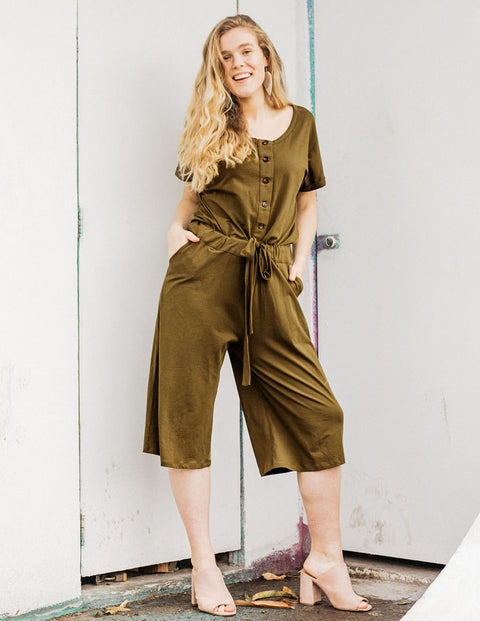 The HALLIE button front bloussant tie-front jumpsuit in Military Olive