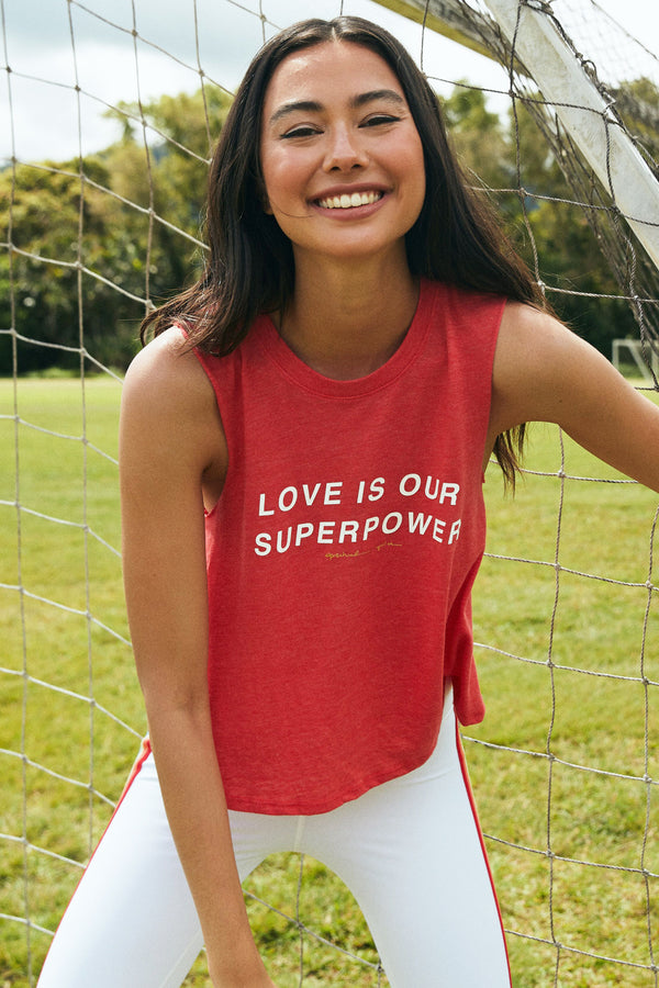LOVE IS OUR SUPERPOWER CROP TANK