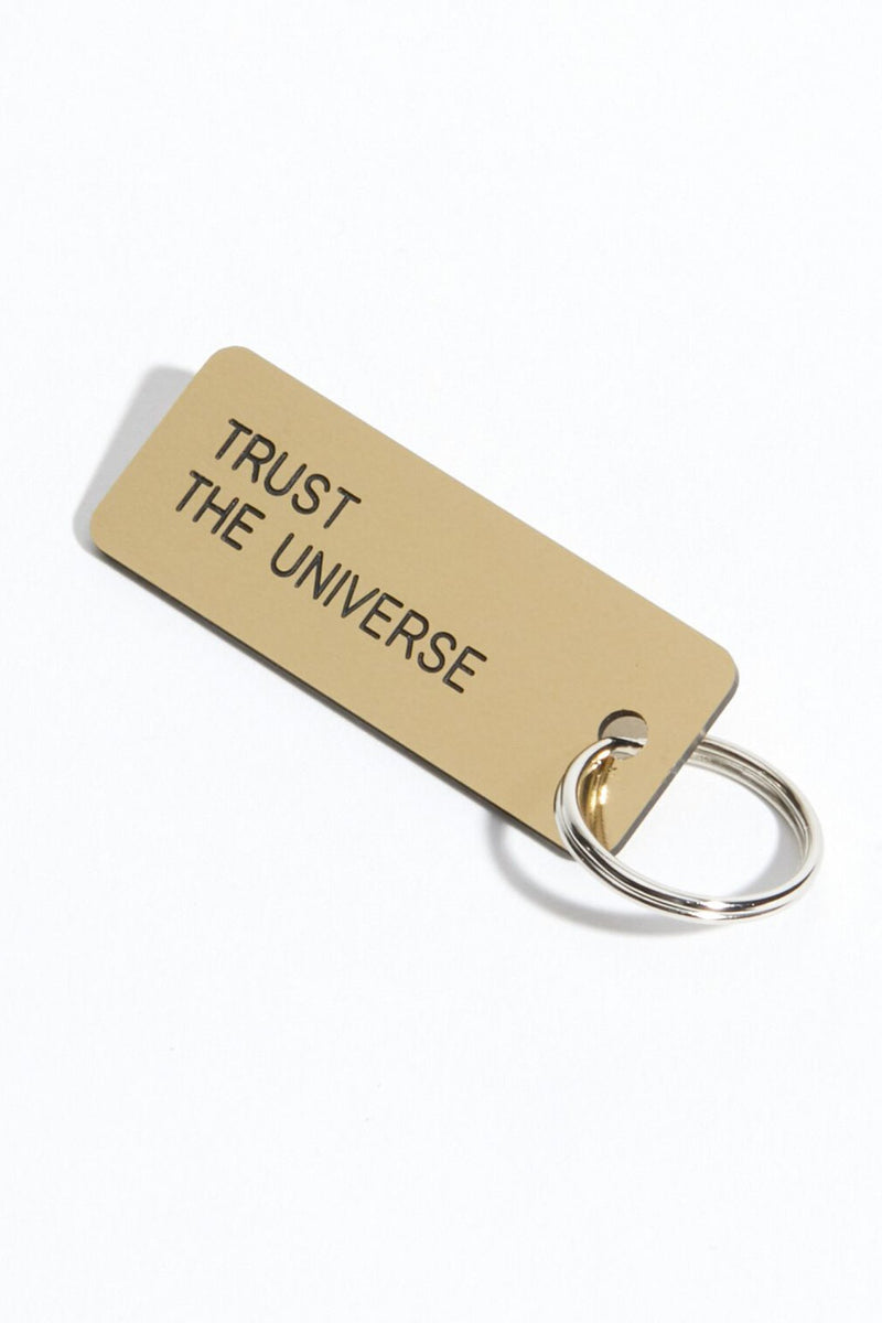 TRUST THE UNIVERSE KEYTAG BRUSHED GOLD