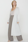 The ultimate in femininity, the Kai Duster cardigan envelopes you in a gorgeous silk-cotton blend that gently skims your body in a maxi length. An essential layering piece, it flows gracefully with each movement. The robe-like, open front makes it an easy style to wear with everything and the rolled trim on the hem and cuffs add thoughtful detail.