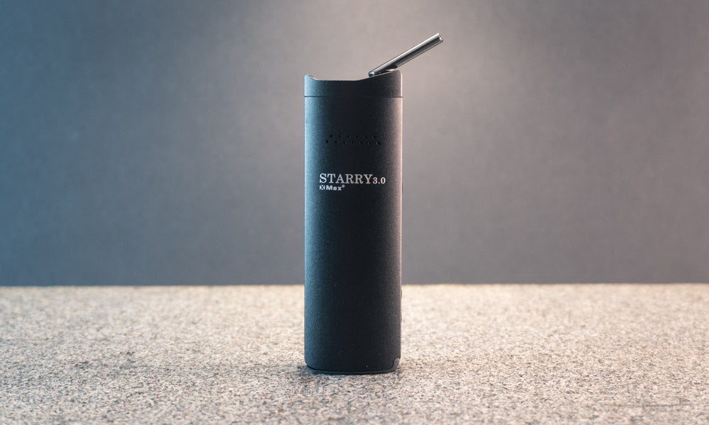XMAX Starry v3 vaporiser on stone with black background