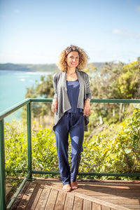 Made in New Zealand merino cardigan with long sleeves and wide drape hem.