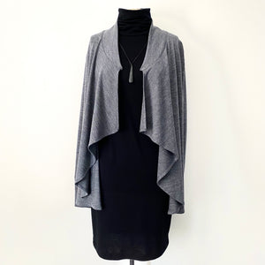 Marle grey merino long cardigan worn over black merino turtle neck dress