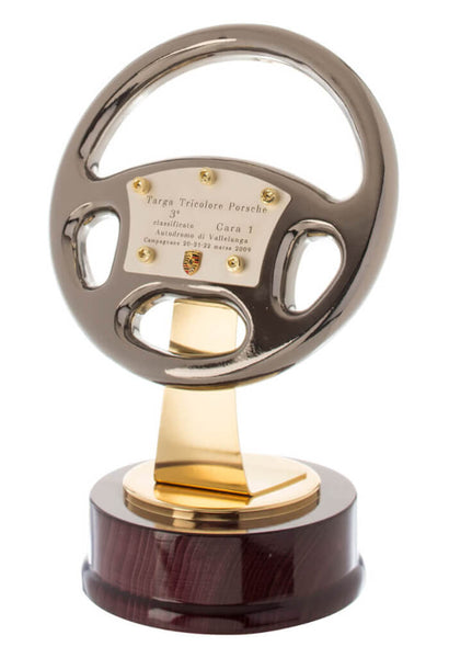 7900/1 Sedan - Silver, gold and titanium racing wheel trophy with wood base.