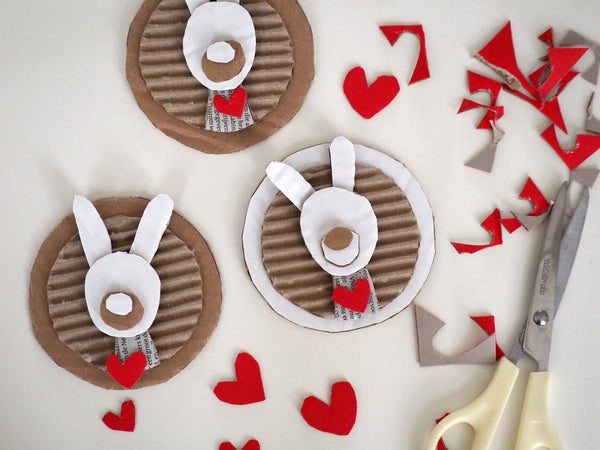 Handmade Cardboard Bunnies. Love hearts are also cardboard cut outs.