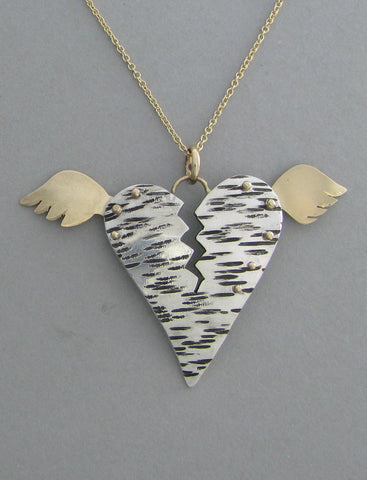 silver and gold heart pendant necklace with wings