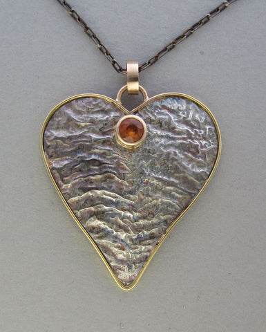 silver reticulated heart pendant with gold and gemstone