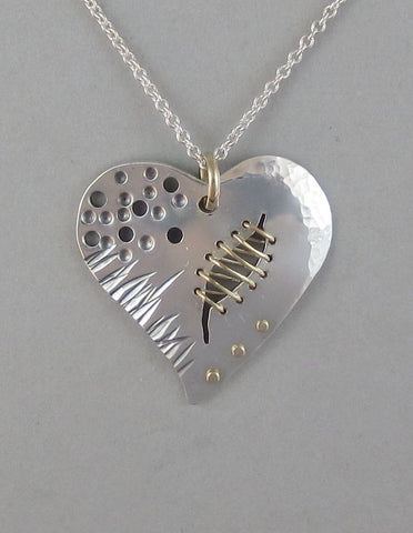 sterling silver heart pendant necklace with gold broken heart