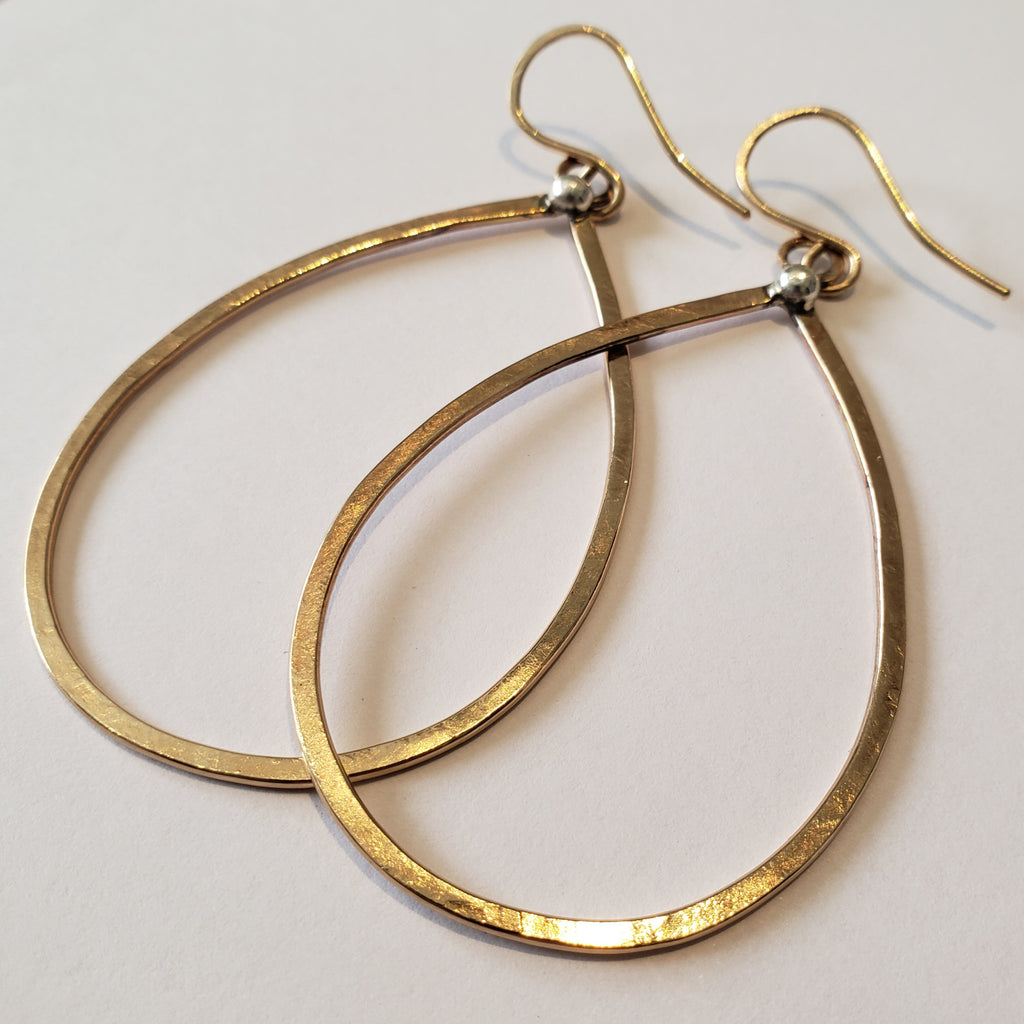 Large gold hammered hoop earrings