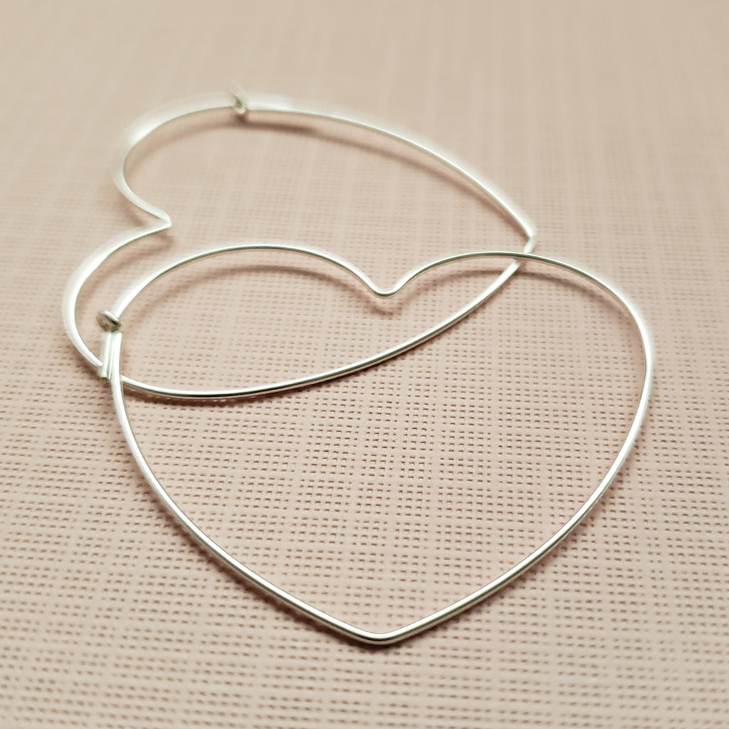Lightweight silver heart hoops