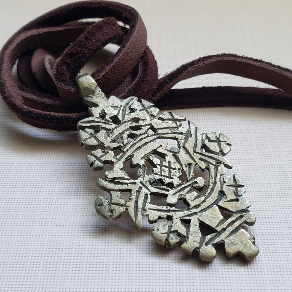 Rustic vintage cross pendant on leather