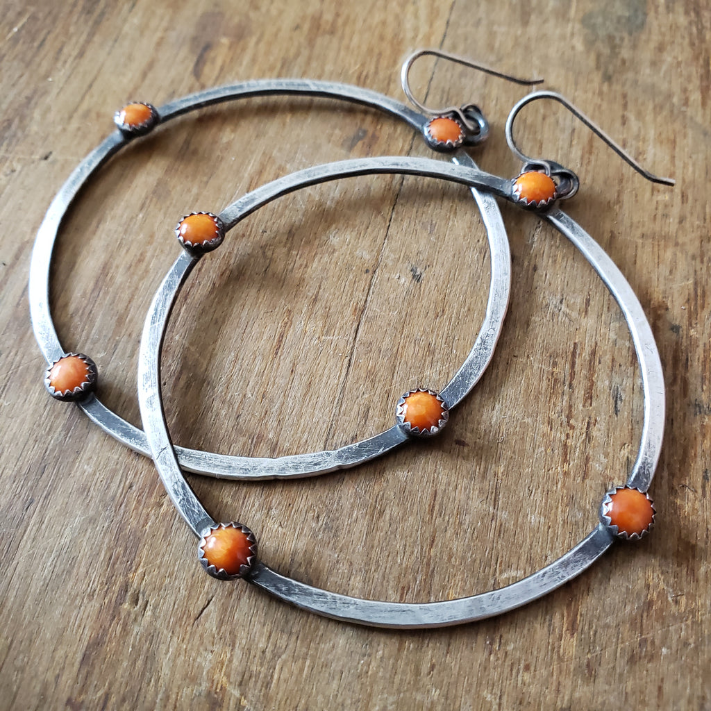 Large orange hoop earrings