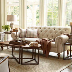 Tufted white sofa