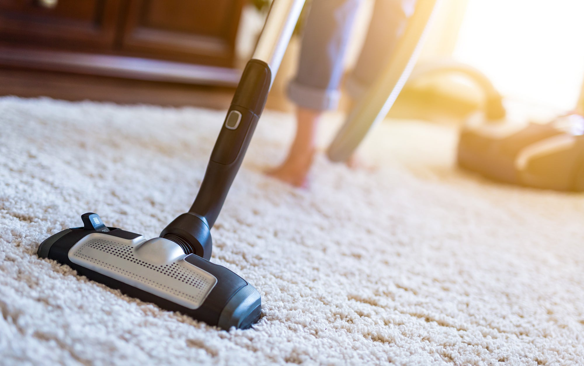 vacuum the rug and under the couch