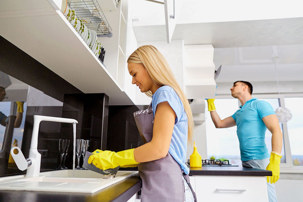 couple cleaning their kitchen