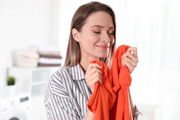 woman smelling her fresh top