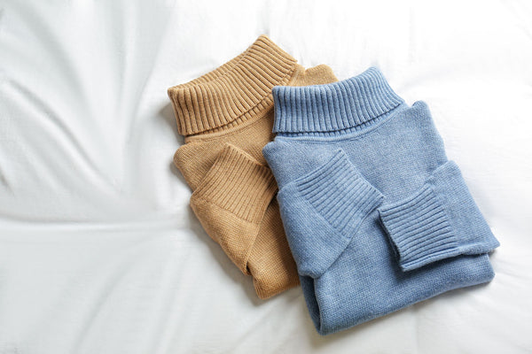 neatly folded roll neck knitted pullovers