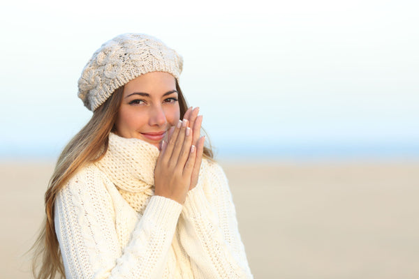 a woman looking warm and snug in fresh cream knits