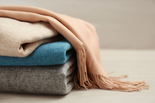 a luxurious pile of cashmere garments