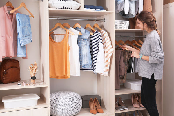 An organised closet space with high and low shelves