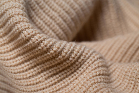 a swathe of woolen knitted fabric