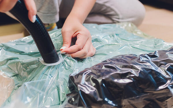 items being vacuum packed in a storage bag