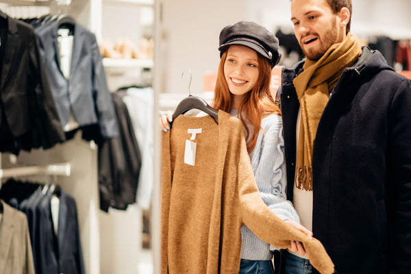 couple shopping for cashmere sweaters