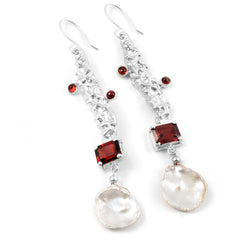 Garnet and baroque pearl accent earrings in sterling silver.