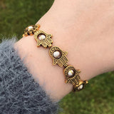 Gold Hamsa and White Bead Stretch Bracelet