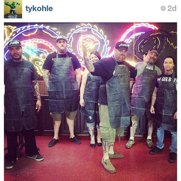 Ink Addiction Tattooists wearing S&R aprons