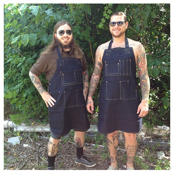 Dennis Hickman and Justin Johnson in aprons
