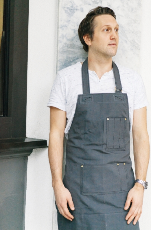 Co-Founder Stephen Collins Field and Social wearing Search and Rescue Denim Co Apron