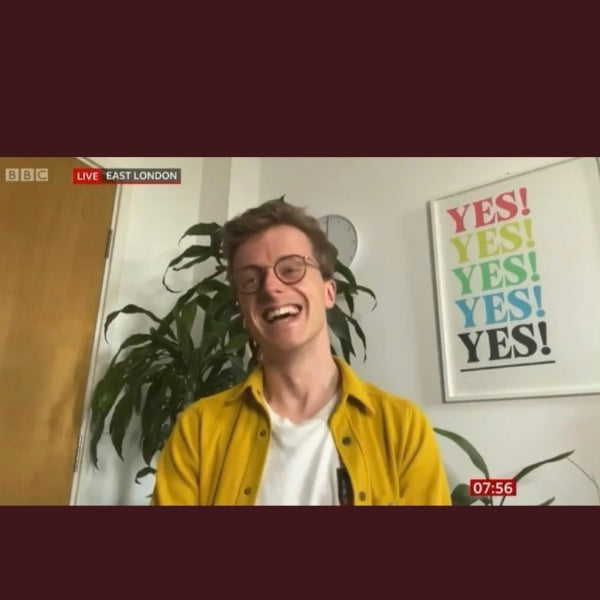 Scott Bryan interview on BBC Breakfast sitting in front of colourful YES! print