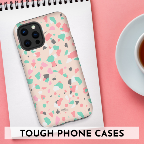 Kin and Castle tough phone cases - image shows terrazzo phone case on notepad, next to cup of tea on pink desk