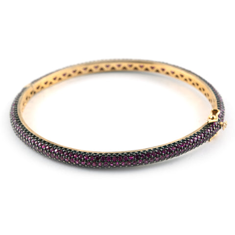 Pink sapphire and gold bangle