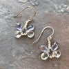 Handmade, one of a kind, sterling silver and blue topaz and iolite gemstones create these dragonfly earrings. Garden of Silver in Westhampton Beach, Long Island, Hamptons, New York.