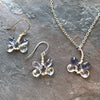 Handmade, one of a kind, sterling silver and blue topaz and iolite gemstones create these dragonfly earrings and necklace.. Garden of Silver in Westhampton Beach, Long Island, Hamptons, New York