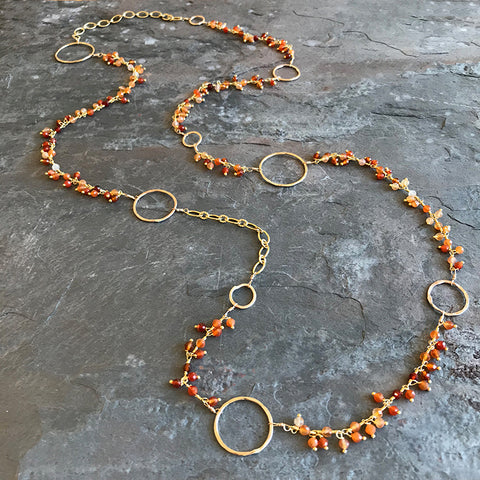 Fire Opal Moon Necklace handmade by Garden of Silver and available at 77 Main Street, Westhampton Beach, New York
