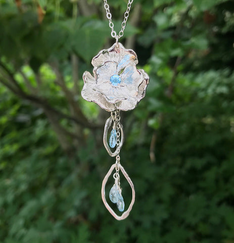 Blue topaz gemstone handmade poppy flower necklace by Garden of Silver.