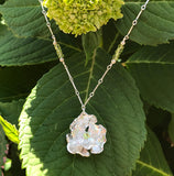 Peridot Poppy Necklace handmade by Garden of Silver with gemstones and sterling silver.