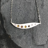 Sunset Wave Necklace handmade with brown, yellow and white diamonds and sterling silver by Garden of Silver in East Hampton.