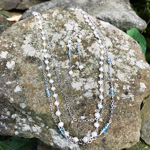 Sea Treasures Earrings and Necklace handmade by Garden of Silver with pearls and blue zircon gemstones and sterling silver.