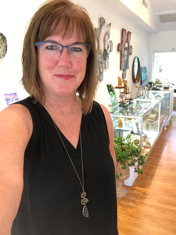 Eileen Baumeister McIntyre wearing gold jewelry by Melissa Joy Manning at Garden of Silver in Westhampton Beach, New York.
